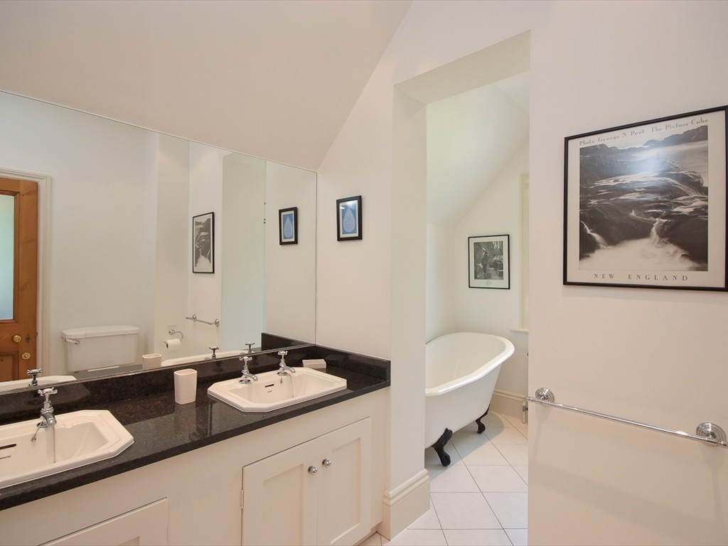 family bathroom with roll top bath and walk in shower